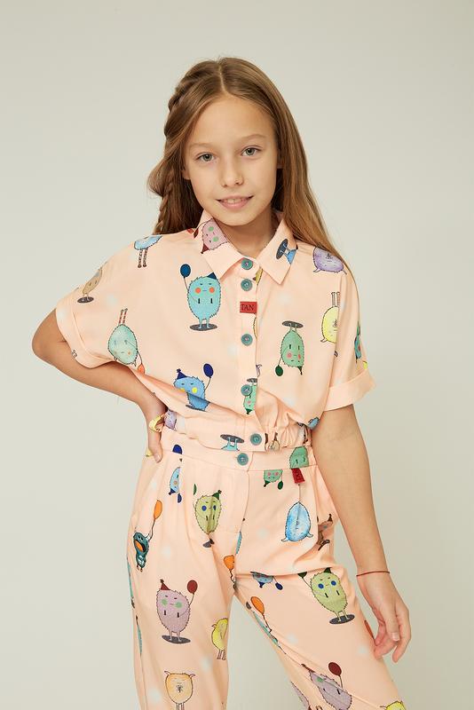 Дитяча рожева блузка з гумкою на талії — K60025